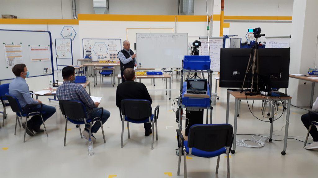 Lean Management Hybrid Workshop zum Wertstromdesign im IMPULS Trainingscenter.